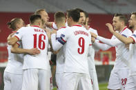 Poland players celebrate scoring their side's first goal during the Nations League soccer match between Poland and The Netherlands at Silesian Stadium in Chorzow, Poland, Wednesday, Nov. 18, 2020. (AP Photo/Czarek Sokolowski)