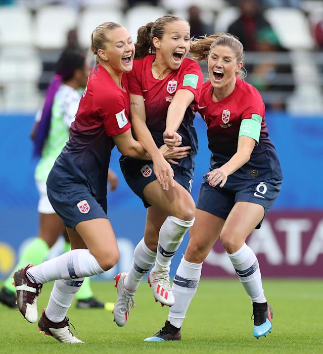 Guro Reiten of Norway celebrates scoring the opening goal with Lisa-Marie Utland and Maren Mjelde during the 2019 FIFA Women's World Cup France group A match between Norway and Nigeria at Stade Auguste Delaune on June 8, 2019 in Reims, France. (Photo by Charlotte Wilson/Offside/Getty Images)