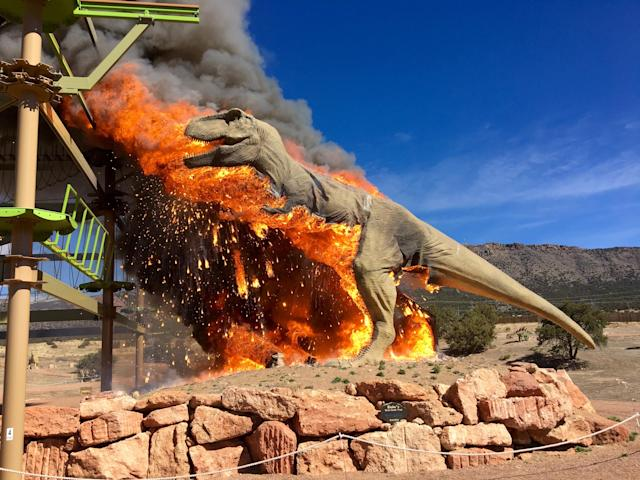 Smoke rises from a replica of a T-Rex after it burst into flames at the Royal Gorge Dinosaur Experience in Canon City, Colorado, U.S. in this picture obtained from social media March 22, 2018. Royal Gorge Dinosaur Experience/via REUTERS THIS IMAGE HAS BEEN SUPPLIED BY A THIRD PARTY. MANDATORY CREDIT.NO RESALES. NO ARCHIVES TPX IMAGES OF THE DAY