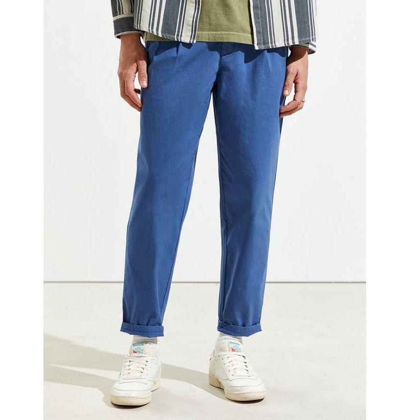 """<p><strong>Dockers</strong></p><p>urbanoutfitters.com</p><p><strong>$49.99</strong></p><p><a href=""""https://go.redirectingat.com?id=74968X1596630&url=https%3A%2F%2Fwww.urbanoutfitters.com%2Fshop%2Fdockers-uo-exclusive-pleated-pant%3Fcategory%3Dmens-jeans-pants-sale%26color%3D062%26type%3DREGULAR%26quantity%3D1&sref=https%3A%2F%2Fwww.esquire.com%2Fstyle%2Fmens-fashion%2Fg32631767%2Fsummer-mens-fashion-memorial-day-sale%2F"""" rel=""""nofollow noopener"""" target=""""_blank"""" data-ylk=""""slk:Buy"""" class=""""link rapid-noclick-resp"""">Buy</a></p><p>When it's too damn hot to wear denim of any kind, opt for a pair of lightweight, cropped chinos instead. </p>"""