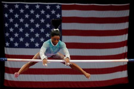 FILE PHOTO: Simone Biles competes on uneven bars at the U.S. Gymnastics Championships in Boston, Massachusetts, U.S., August 19, 2018. REUTERS/Brian Snyder/File Photo