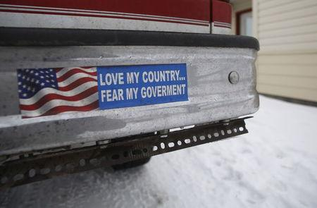 A bumper sticker on a private truck is seen in front of a residential building at the Malheur National Wildlife Refuge near Burns, Oregon, January 5, 2016. REUTERS/Jim Urquhart