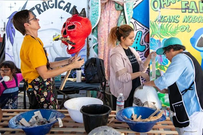 LOS ANGELES, CA - OCTOBER 26, 2019: Kristen Johannesen, Olivia Ramos and her mother Dora Magaña, from left, work on paper mache skulls for Day of the Dead at the Self Help Graphics Community Arts Workshop. (Michael Owen Baker / For The Times)