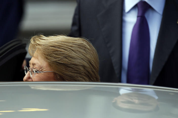President-elect Michelle Bachelet, greets supporters after meeting with different authorities invited to the presidential inauguration, in Santiago, Chile, Monday, March 10, 2014. Bachelet will be sworn in as Chile's president on Tuesday. (AP Photo/Luis Hidalgo)