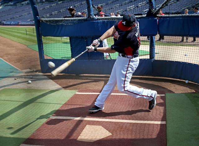 Atlanta Braves catcher Brian McCann swings during batting practice Wednesday, Oct. 2, 2013, in Atlanta. The Braves are scheduled to play the Los Angeles Dodgers in Game 1 of baseball's NL division series on Thursday. (AP Photo/Atlanta Journal Constitution, Jason Getz)