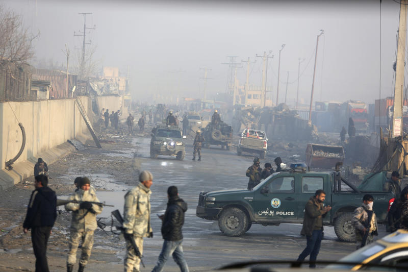 Afghan security forces gather at the site a day after an attack in Kabul, Afghanistan, Tuesday, Jan. 15, 2019. A Taliban suicide bomber detonated an explosive-laden vehicle in the capital Kabul on Monday evening, according to officials. (AP Photo/Rahmat Gul)