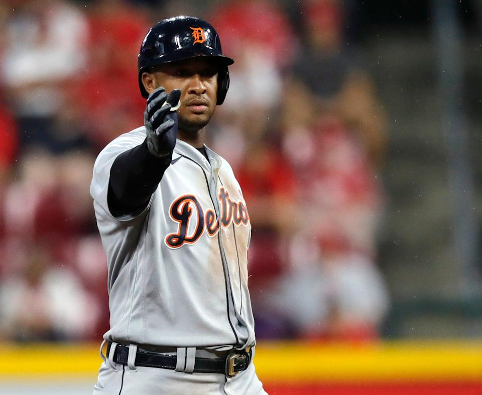 Tigers second baseman Jonathan Schoop reacts at second base after hitting a double against the Reds during the third inning on Saturday, Sept. 4, 2021, in Cincinnati.