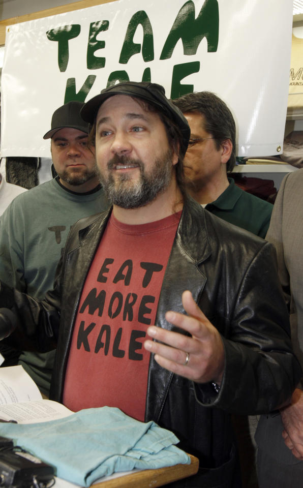 """Bo Muller-Moore speaks at a news conference on Monday, Dec. 5, 2011 in Montpelier, Vt. Vermont Gov. Peter Shumlin is throwing his support behind Muller-Moore, the Montpelier folk artist who has built his T-shirt business around the phrase """"eat more kale"""" and is engaged in a trademark fight with the second largest chicken restaurant chain in the country, Chick-fil-A. (AP Photo/Toby Talbot)"""