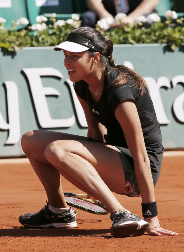 Ana Ivanovic of Serbia falls during her women's semi-final match against Lucie Safarova of the Czech Republic at the French Open tennis tournament at the Roland Garros stadium in Paris, France, June 4, 2015. REUTERS/Gonzalo Fuentes
