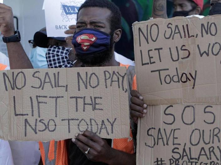 Miami, Florida, September 28, 2020-A protester holds a sign urging the end to the no-sail order. A group of longshoremen, travel agents and other professionals who depend on the cruise industry for employment held a rally at PortMiami Terminal D to urge the CDC to lift the no-sail order for cruising and allow the industry to restart.
