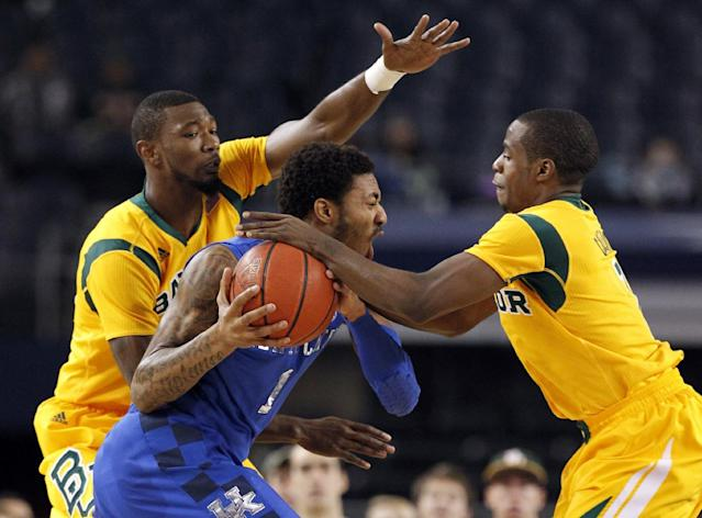 Baylor's Cory Jefferson, left, and Kenny Chery, right, stop a drive to the basket by Kentucky's James Young (1) in the first half of an NCAA college basketball game, Friday, Dec. 6, 2013, in Arlington, Texas. (AP Photo/Tony Gutierrez)