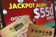 Powerball and Mega Millions lottery tickets are shown at a retailer, Wednesday, Jan. 13, 2021, in Surfside, Fla. Lottery players will have a shot Friday night at the fifth-largest jackpot in U.S. history after no tickets matched all the numbers in the latest Mega Millions drawing. The big prize for Powerball, the other national lottery game, is $550 million for Wednesday night's drawing. (AP Photo/Wilfredo Lee)