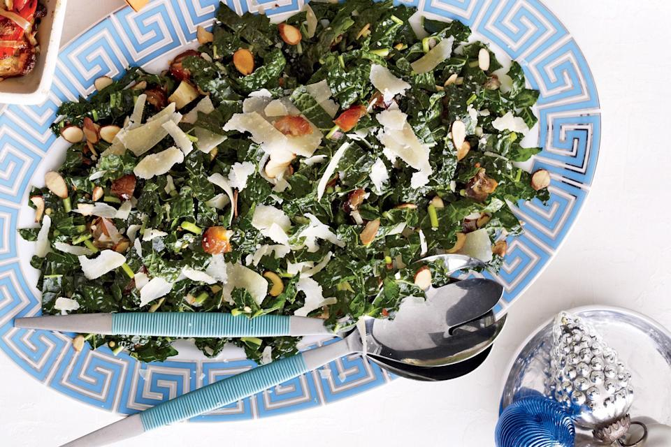 """To get one more thing off your checklist, dress the kale a day ahead, then toss with the crunchy, sweet, and salty toppings just before serving. <a href=""""https://www.epicurious.com/recipes/food/views/kale-salad-with-dates-parmesan-and-almonds-51137020?mbid=synd_yahoo_rss"""" rel=""""nofollow noopener"""" target=""""_blank"""" data-ylk=""""slk:See recipe."""" class=""""link rapid-noclick-resp"""">See recipe.</a>"""