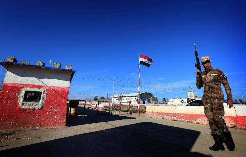 An Iraqi soldier stands guard at the entrance of the Nineveh base for liberation operations in Makhmur in February (AFP Photo/Safin Hamed)
