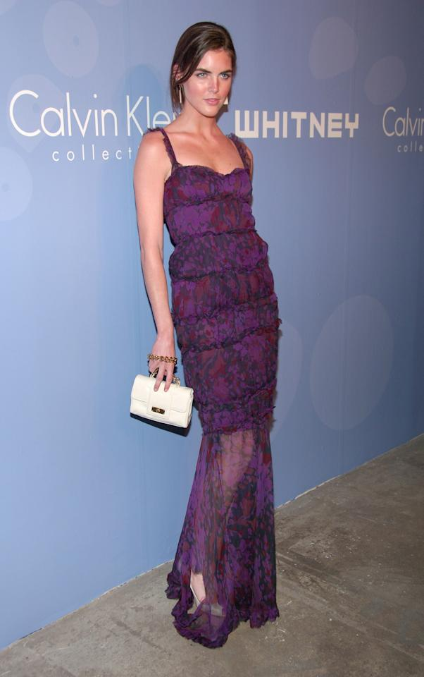 <p>At a party at the Whitney Museum, Rhoda shows off her tan in a semi-sheer purple printed dress.</p>