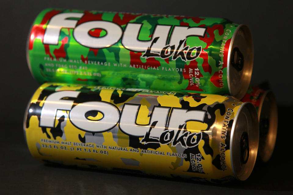 """Cans of fruit-flavored malt liquor called Four Loko are seen in Washington on Wednesday, Feb. 29, 2012, in Washington. The carbonated brew guzzled on college campuses is the focus of an intense write-in campaign urging federal regulators to take some buzz out of a sweet alcoholic drink sometimes referred to as """"blackout in a can."""" The Federal Trade Commission is looking at a wave of complaints about the popular fruit-flavored malt liquor Four Loko. Under review: the amount of alcohol in the brightly colored, supersized cans and how they are marketed. (AP Photo/Haraz Ghanbari)"""