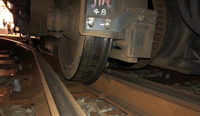 The wheels of an MTR light rail train that skipped the tracks as it entered the platform at the Siu Hong stop on Saturday night. Photo: Handout