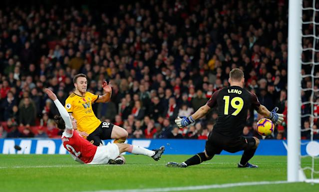 """Soccer Football - Premier League - Arsenal v Wolverhampton Wanderers - Emirates Stadium, London, Britain - November 11, 2018 Wolverhampton Wanderers' Diogo Jota shoots at goal REUTERS/Eddie Keogh EDITORIAL USE ONLY. No use with unauthorized audio, video, data, fixture lists, club/league logos or """"live"""" services. Online in-match use limited to 75 images, no video emulation. No use in betting, games or single club/league/player publications. Please contact your account representative for further details."""