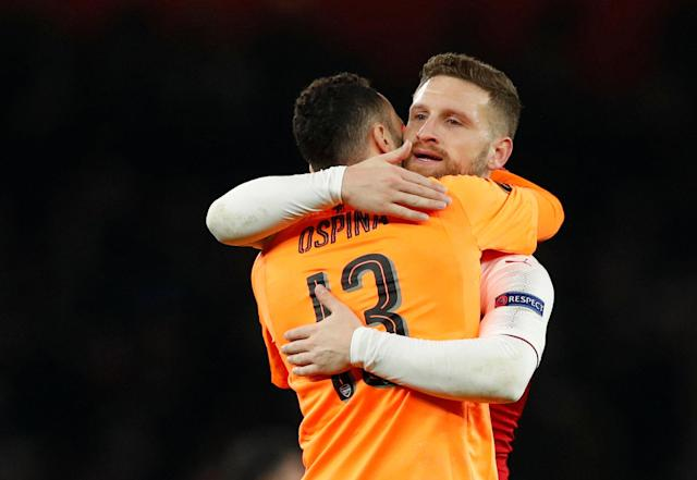 Soccer Football - Europa League Round of 16 Second Leg - Arsenal vs AC Milan - Emirates Stadium, London, Britain - March 15, 2018 Arsenal's David Ospina and Shkodran Mustafi celebrate after the match Action Images via Reuters/John Sibley