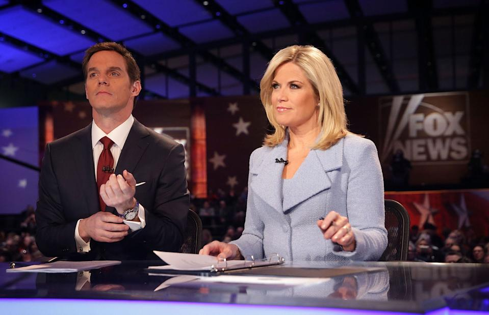 Moderators Martha MacCallum and Bill Hemmer wait for the beginning of the first forum of the Fox News in 2016.