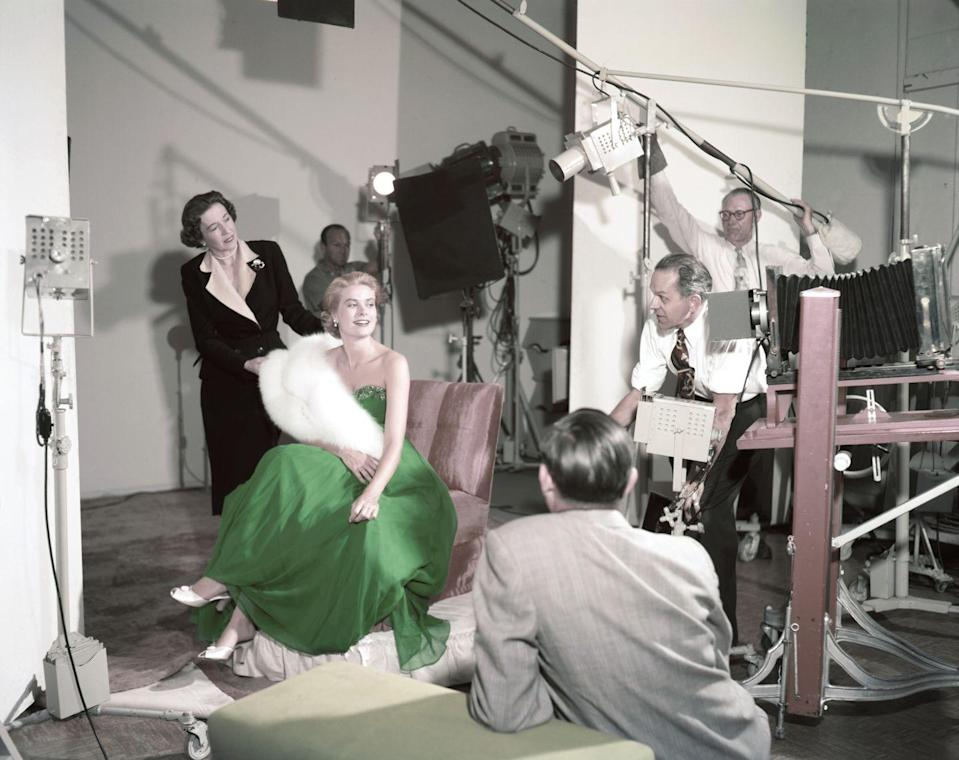 <p>Kelly poses in a bright green ballgown and white fur stole for a St. Patrick's Day photoshoot in 1954. </p>