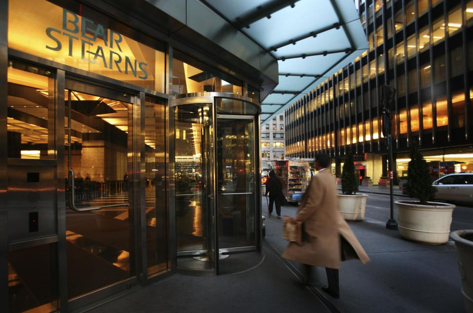 ** FILE ** In this March 17, 2008 file photo, an employee enters Bear Stearns in New York. Bear Stearns Cos. shareholders on Thursday, May 29, 2008 approved JPMorgan Chase & Co.'s $2.2 billion buyout of the investment bank whose wagers on subprime mortgages made it the largest corporate casualty of the global credit crisis. (AP Photo/Mark Lennihan, file)