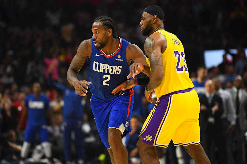LOS ANGELES, CA - OCTOBER 22: Los Angeles Clippers Forward Kawhi Leonard (2) and Los Angeles Lakers Guard LeBron James (23) look on during a NBA game between the Los Angeles Lakers and the Los Angeles Clippers on October 22, 2019 at STAPLES Center in Los Angeles, CA. (Photo by Brian Rothmuller/Icon Sportswire via Getty Images)