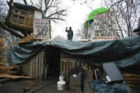 The encampment in Euston Square Gardens in central London, Wednesday Jan. 27, 2021. Protesters against a high-speed rail link between London and the north of England said Wednesday that some of them have been evicted from a park in the capital after they dug tunnels and set up a makeshift camp. (Aaron Chown/PA via AP)