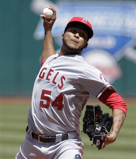 Los Angeles Angels starting pitcher Ervin Santana throws against the Cleveland Indians in the first inning of a baseball game in Cleveland, Sunday, April 29, 2012. (AP Photo/Amy Sancetta)