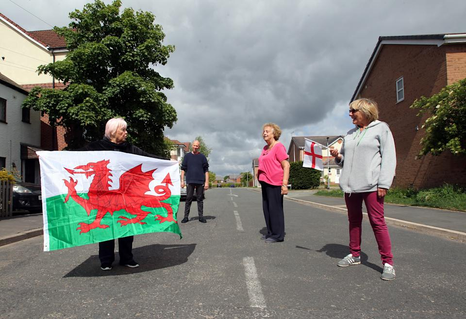 Cllr Veronica Gay and fellow Welsh resident Alan William Brumby (left) live on the same street as English residents Anne Amboorallee and Linda Astbury (right) but the road is the border between Flintshire in North Wales and Cheshire, England, which are subject to different lockdown restrictions. (Picture: Ian Cooper)