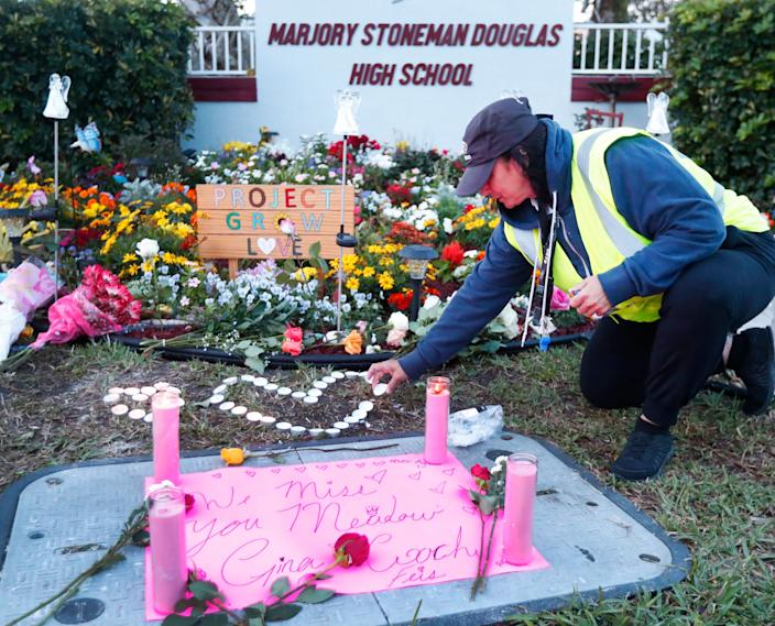 Crossing guard Wendy Behrend at a memorial outside Marjory Stoneman Douglas High School during the one-year anniversary of the school shooting. (Photo: Wilfredo Lee/AP)