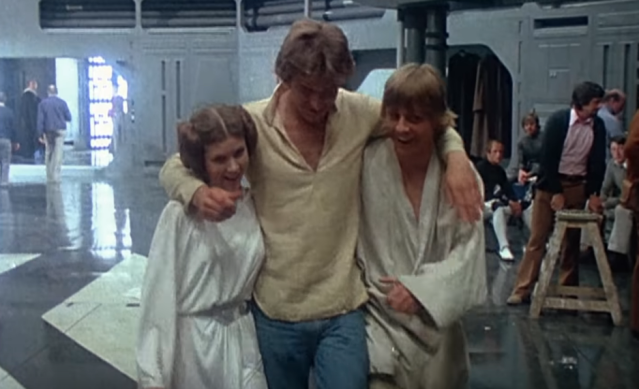 Carrie Fisher, Harrison Ford and Mark Hamill on the set of Star Wars (Credit: Lucasfilm)