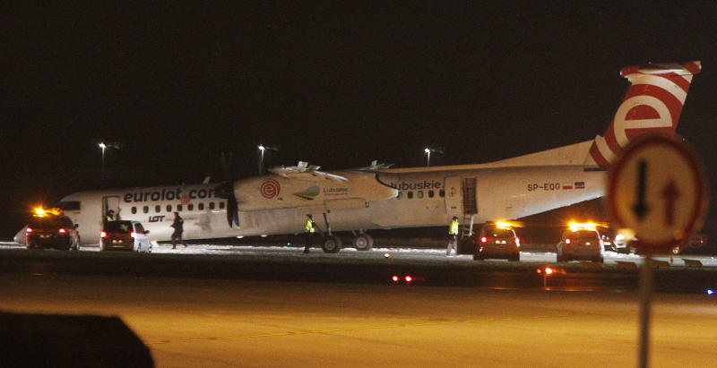 A Polish LOT airline passenger plane with its nose down on the runway after making an emergency landing with 59 passengers and four crew aboard at the international Chopin Airport in Warsaw, Poland, Wednesday, Jan. 10, 2018. Authorities think the front wheel malfunctioned during landing, but nobody was injured in the incident. (AP Photo/Czarek Sokolowski)