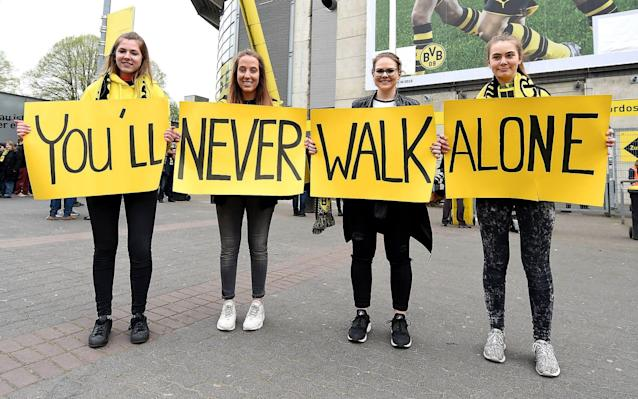 <span>Dortmund fans spread messages of support outside the ground</span> <span>Credit: Rex Features/Action Press/REX/Shutterstock </span>
