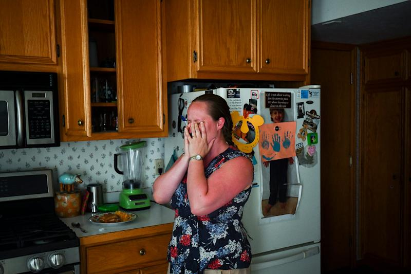 Whitney Phinney reacts to realizing she prepaid for a day of preschool her son can't attend because he's sick. Money is tight, and the Phinneys are in the red every month.