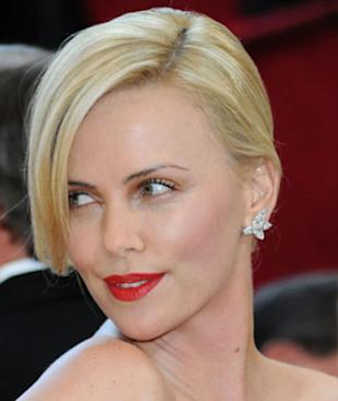 Be bold with a red lip like Theron is here.