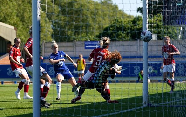 Bethany England, third left, scores Chelsea Women's sixth goal in Sunday's 9-0 win against Bristol City Women. Arsenal Women won 9-1 at 10-player West Ham Women on Saturday