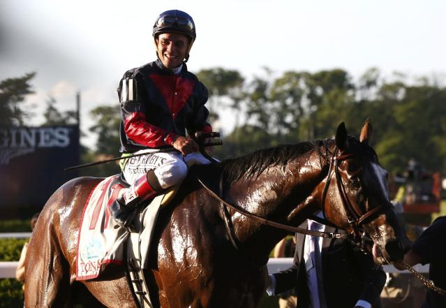 Jockey Joel Rosario, in the irons on Tonalist, smiles after winning the 146th running of the Belmont Stakes at Belmont Park in Elmont, New York June 7, 2014. REUTERS/Shannon Stapleton (UNITED STATES - Tags: SPORT HORSE RACING)