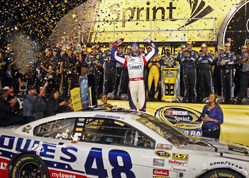 Jimmie Johnson celebrates in victory lane after winning the NASCAR All-Star auto race at Charlotte Motor Speedway in Concord, N.C., Saturday, May 18, 2013. (AP Photo/Nell Redmond)