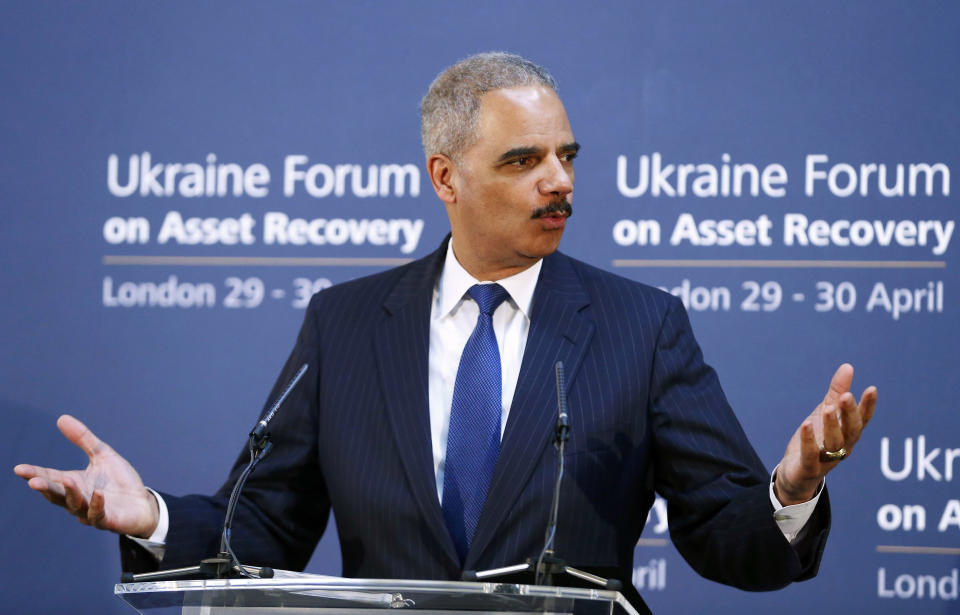 """<p> U.S. Attorney General Eric Holder speaks at the Ukraine Forum on Asset Recovery in central London, Tuesday April 29, 2014. Britain and the United States are co-hosting the two-day """"asset recovery forum"""" designed to help find and recover assets believed to have been stolen by the regime of ousted Ukrainian president Viktor Yanukovych. (AP Photo/Andrew Winning, Pool) </p>"""