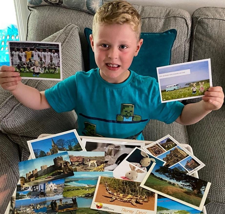 Ethan Mccann with all of the post cards he has received. See SWNS copy SWPLrabbit: A boy who lost his precious Peter Rabbit toy on a bus has received postcards from around the world from people saying they are Peter - and he is just on holiday. The little rabbit, dressed in a tiny replica of David Beckham's kit from the 1998 World Cup, went missing on a bus ride in Torbay. His six-year-old owner Ethan Mccann was left heartbroken – after multiple attempts to locate the missing bunny were unsuccessful.
