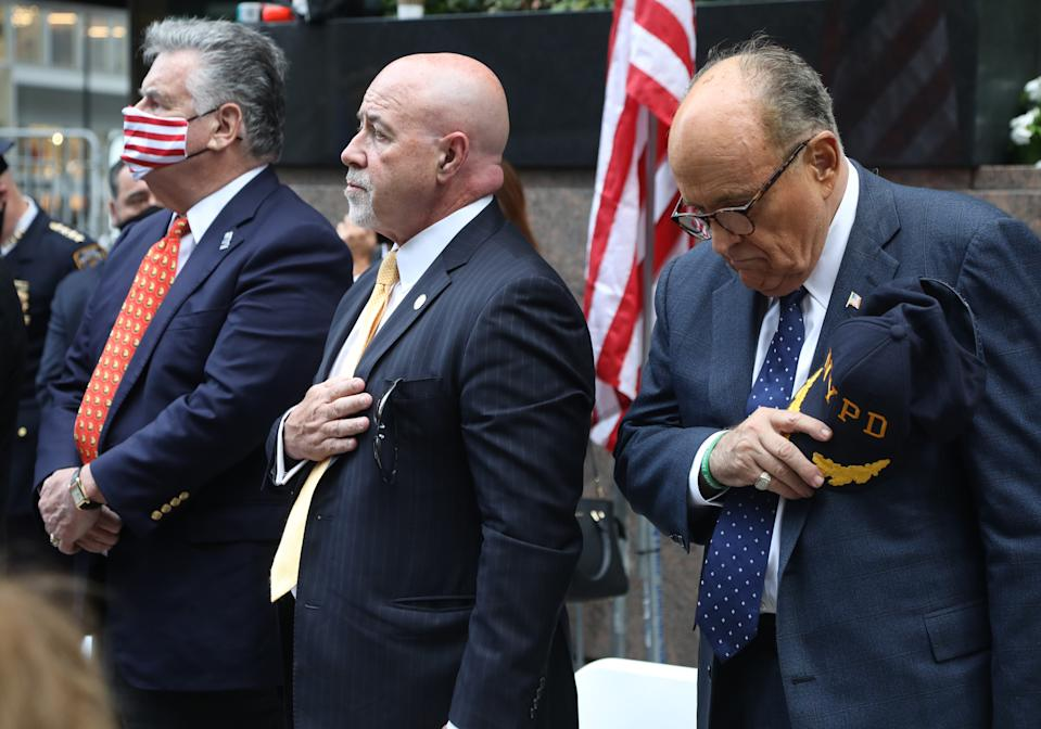 Congressman Peter King, former NY City Police Chief Bernard Kerik and former NY Mayor Rudy Giuliani during the national anthem. The ceremony and reading the names of victims of the attacks of 911 were moved to Zuccotti Park, a block up from the World Trade Center Memorial in lower Manhattan, NY on Sept. 11, 2020.