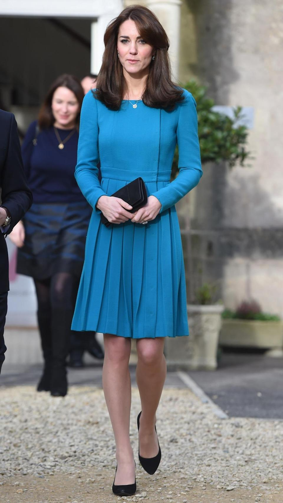 <p>On a charity visit, Kate wore a bespoke teal Emilia Wickstead dress with pleated skirt. She carried her prized Mulberry bag and finished with a pair of Stuart Weitzman heels. </p><p><i>[Photo: PA]</i></p>