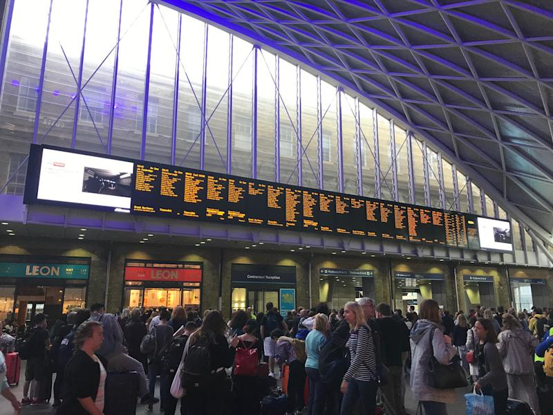 People waiting for trains at King's Cross station, London, after all services in and out of the station were suspended on Friday when a power cut caused major disruption across the country. PRESS ASSOCIATION Photo. Picture date: Saturday August 10, 2019. See PA story ENERGY PowerCut. Photo credit should read: Abbianca Makoni/PA Wire