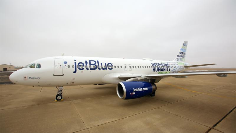 A JetBlue plane on the tarmac.