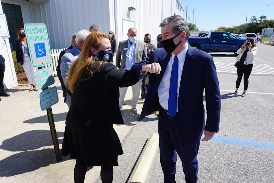 Dare County Health Director Sheila Davies greets Governor Roy Cooper on arrival at the Dare County vaccination clinic held in Kill Devil Hills on Friday, April 16, 2021.