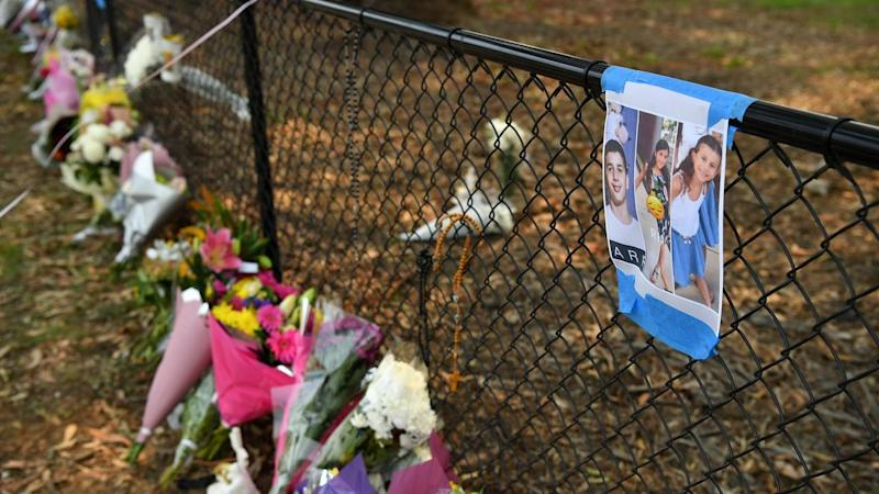 Flowers have been placed at the scene where four children were killed and three injured at Oatlands