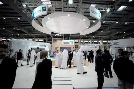 FILE PHOTO: Visitors are seen at the Saudi Aramco stand at the Middle East Process Engineering Conference & Exhibition in Manama