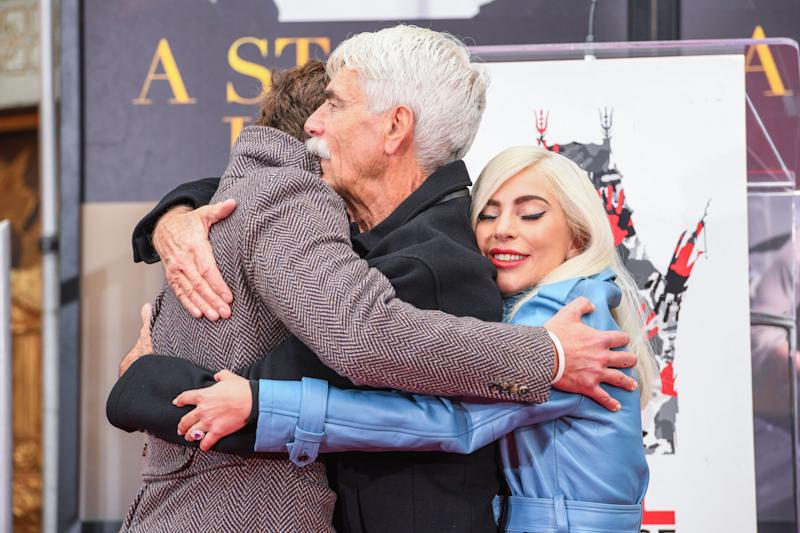 Bradley Cooper, Sam Elliott and Lady Gaga embrace during