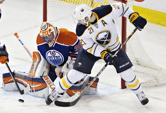 Buffalo Sabres' Drew Stafford (21) is stopped by Edmonton Oilers goalie Ben Scrivens (30) during the second period of an NHL hockey game in Edmonton, Alberta, on Thursday, March 20, 2014. (AP Photo/The Canadian Press, Jason Franson)